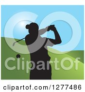 Clipart Of A Black Silhouetted Male Golfer Swinging Over Hills And Blue Sky Royalty Free Vector Illustration