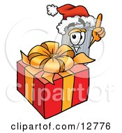 Clipart Picture Of A Garbage Can Mascot Cartoon Character Standing By A Christmas Present