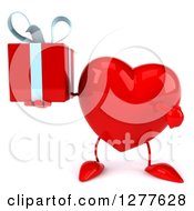 Clipart Of A 3d Heart Character Holding And Pointing To A Gift Royalty Free Illustration