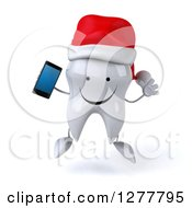 Clipart Of A 3d Happy Christmas Tooth Character Jumping And Holding A Smart Phone Royalty Free Illustration