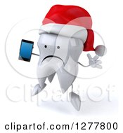 Clipart Of A 3d Unhappy Christmas Tooth Character Facing Left Jumping And Holding A Smart Phone Royalty Free Illustration