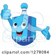 Happy Blue Dreidel Top Toy Holding A Thumb Up And Spinning