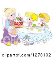 Happy Caucasian Granny Serving A Christmas Cake To Children And A Cat At A Tea Party