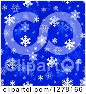 Seamless Christmas Background Of White Winter Snowflakes On Blue