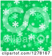 Seamless Christmas Background Of White Winter Snowflakes On Green