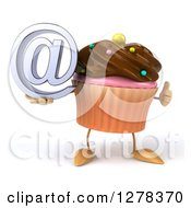 Clipart Of A 3d Chocolate Frosted Cupcake Character Holding A Thumb Up And An Email Arobase Symbol Royalty Free Illustration
