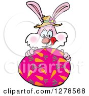 Pink Easter Bunny Licking His Lips Behind A Large Egg