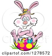 Pink Easter Bunny Sitting On A Broken Egg