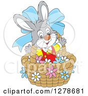 Clipart Of A Happy Gray Easter Bunny Rabbit In A Basket With A Blue Bow And Flowers Royalty Free Vector Illustration