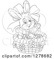 Clipart Of A Black And White Happy Easter Bunny Rabbit In A Basket With A Bow And Flowers Royalty Free Vector Illustration