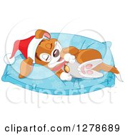 Cute Happy Christmas Puppy Dog Wearing A Santa Hat And Resting On A Comfortable Pillow