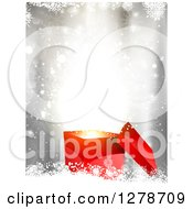 Clipart Of A 3d Red Christmas Gift Box With Surprise Lights Over Bokeh And Snowflakes Royalty Free Vector Illustration