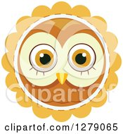 Clipart Of A Cute Owl Face On An Orange Badge Royalty Free Vector Illustration