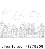 Clipart Of A Black And White Row Of Urban Apartment Buildings And Clouds Royalty Free Vector Illustration