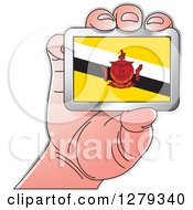 Clipart Of A Caucasian Hand Holding A Brunei Flag Royalty Free Vector Illustration by Lal Perera