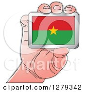 Clipart Of A Caucasian Hand Holding A Burkina Faso Flag Royalty Free Vector Illustration