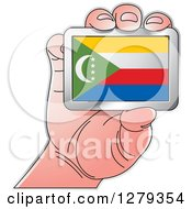 Clipart Of A Caucasian Hand Holding A Comorian Flag Royalty Free Vector Illustration