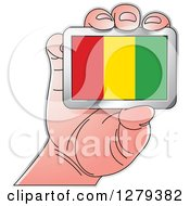 Clipart Of A Caucasian Hand Holding A Guinea Flag Royalty Free Vector Illustration by Lal Perera