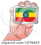 Clipart Of A Caucasian Hand Holding An Ethiopian Flag Royalty Free Vector Illustration