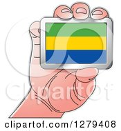 Clipart Of A Caucasian Hand Holding A Gabonese Flag Royalty Free Vector Illustration