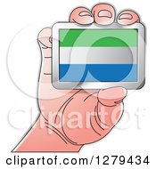 Clipart Of A Caucasian Hand Holding A Sierra Leone Flag Royalty Free Vector Illustration