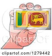 Clipart Of A Caucasian Hand Holding A Sri Lanka Flag Royalty Free Vector Illustration