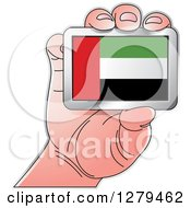 Clipart Of A Caucasian Hand Holding A UAE Flag Royalty Free Vector Illustration