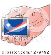 Clipart Of A Caucasian Hand Holding A Marshall Island Flag Royalty Free Vector Illustration
