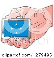 Clipart Of A Caucasian Hand Holding A Micronesia Flag Royalty Free Vector Illustration by Lal Perera