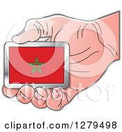 Clipart Of A Caucasian Hand Holding A Morocco Flag Royalty Free Vector Illustration by Lal Perera