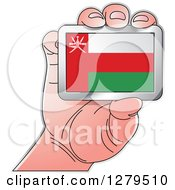 Clipart Of A Caucasian Hand Holding An Oman Flag Royalty Free Vector Illustration by Lal Perera