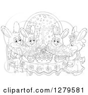 Clipart Of A Cute Black And White Bunny Rabbit Family Sitting Around A Christmas Cake By A Snowy Starry Window Royalty Free Vector Illustration