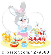 Clipart Of A Cute Gray Female Bunny Rabbit Decorating A Christmas Cake Royalty Free Vector Illustration