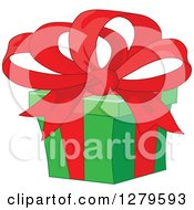 Clipart Of A Green Christmas Gift With A Big Red Bow Royalty Free Vector Illustration