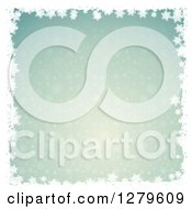 Clipart Of A Green Christmas Winter Background With A Border Of White Snowflakes Royalty Free Vector Illustration