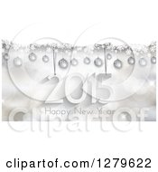 Clipart Of A Suspended 2015 With Happy New Year Text Over Bokeh With Snow And 3d Silver Baubles Royalty Free Vector Illustration