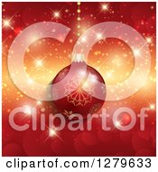 Clipart Of A 3d Suspended Red Snowflake Christmas Ornament Over Bokeh And Sparkles Royalty Free Vector Illustration