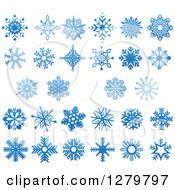 Clipart Of Blue Snowflake Designs Royalty Free Vector Illustration