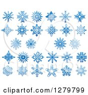 Clipart Of Blue Snowflake Designs 2 Royalty Free Vector Illustration