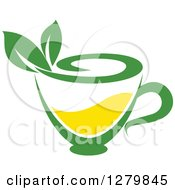 Poster, Art Print Of Green And Yellow Tea Cup With Leaves 3