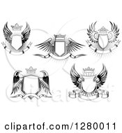 Clipart Of A Black And White Winged Shields Crowns And Banners Royalty Free Vector Illustration