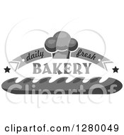 Clipart Of A Grayscale Daily Fresh Bakery Design With A Muffin And Bread Royalty Free Vector Illustration
