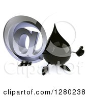 Clipart Of A 3d Oil Drop Character Holding Up A Thumb And An Arobase Symbol Royalty Free Illustration
