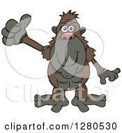 Clipart Of A Happy Ape Holding A Thumb Up Royalty Free Vector Illustration by Dennis Holmes Designs