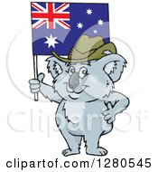 Clipart Of A Happy Koala Holding Up An Australian Flag Royalty Free Vector Illustration