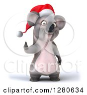 Clipart Of A 3d Christmas Koala Holding A Thumb Up Royalty Free Illustration