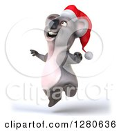 Clipart Of A 3d Christmas Koala Facing Slightly Left And Jumping Royalty Free Illustration