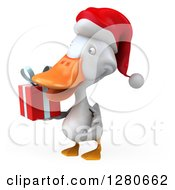 Clipart Of A 3d White Christmas Duck Facing Left And Holding A Gift Royalty Free Illustration