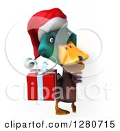 Clipart Of A 3d Christmas Mallard Drake Duck Holding A Gift Around A Sign Royalty Free Illustration