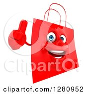 Clipart Of A 3d Happy Red Shopping Or Gift Bag Character Holding A Thumb Up Royalty Free Illustration